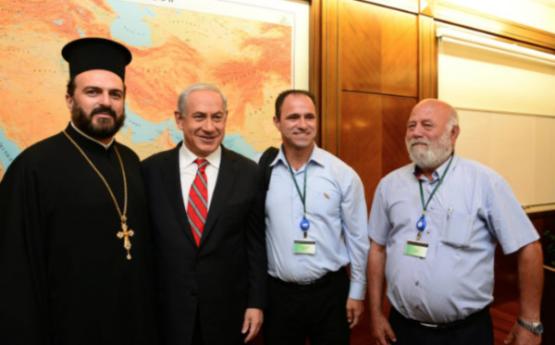 Shadi Khalloul seen standing on Netanyahu left