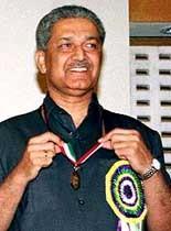 A. Q. Khan receiving a medal